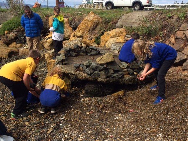 kids building rock pool outside
