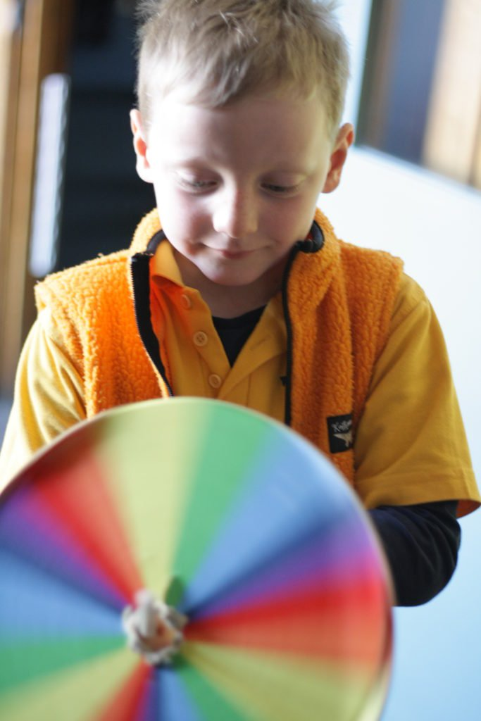 kid with color wheel