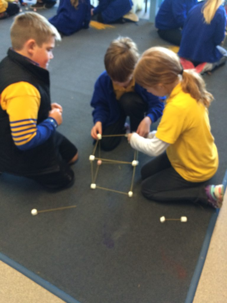 kids building structure with foam balls and skewers