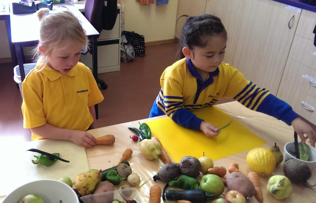 primary kids working with vegetables