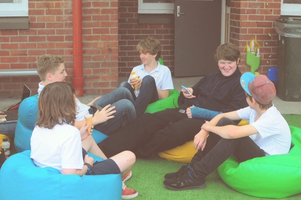 kids hanging out on bean bags